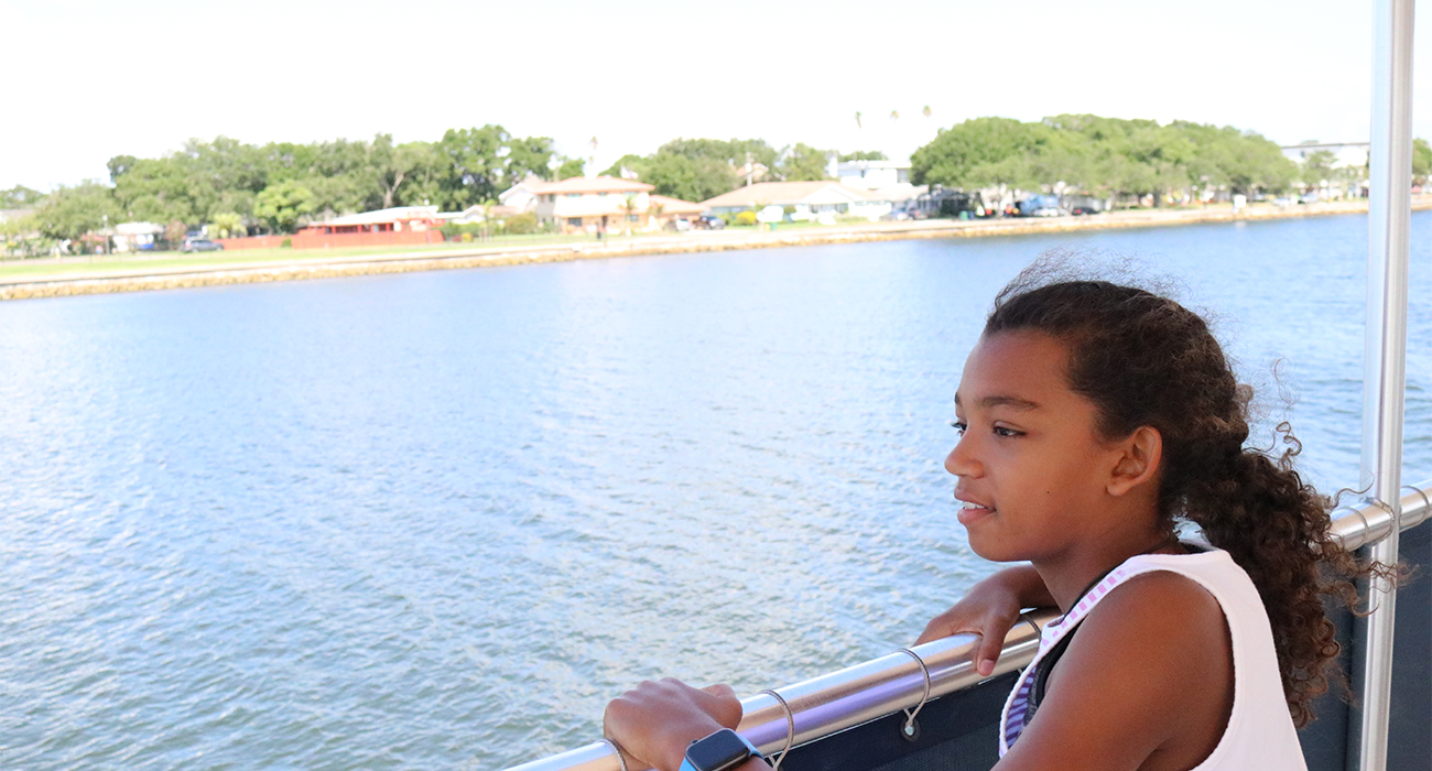 girl_on_boat_looking_at_water